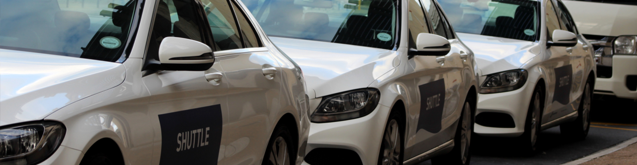 Luxury mercedes benz c-class sedans parking in tandem at conference